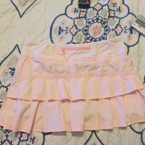 LULULEMON -  light pink short skirts